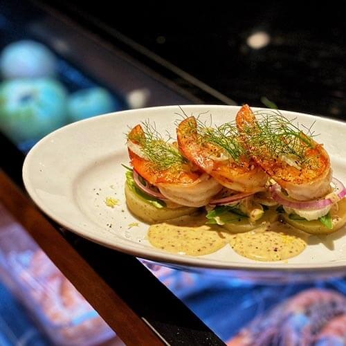 Wild seared Spencer Gulf King Prawns with green vegetables and lemon mustard dressing