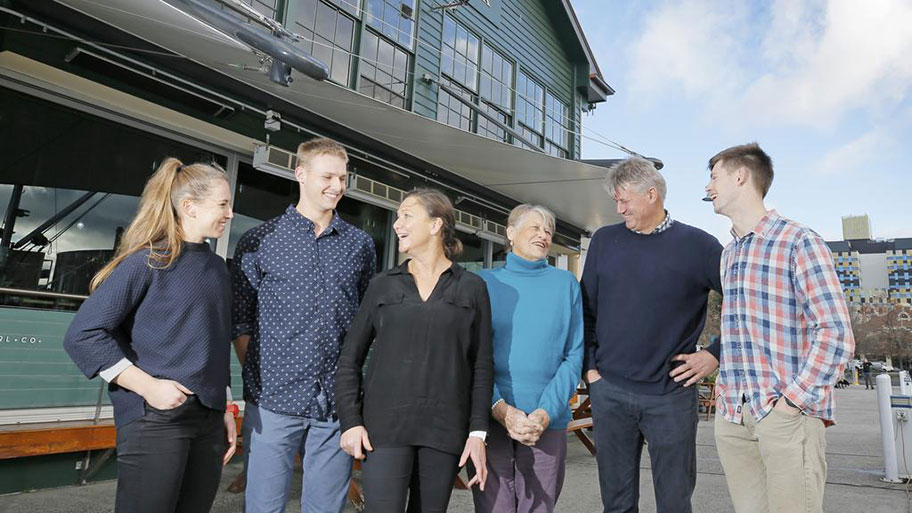 Mure family in front of Mure Fish Centre