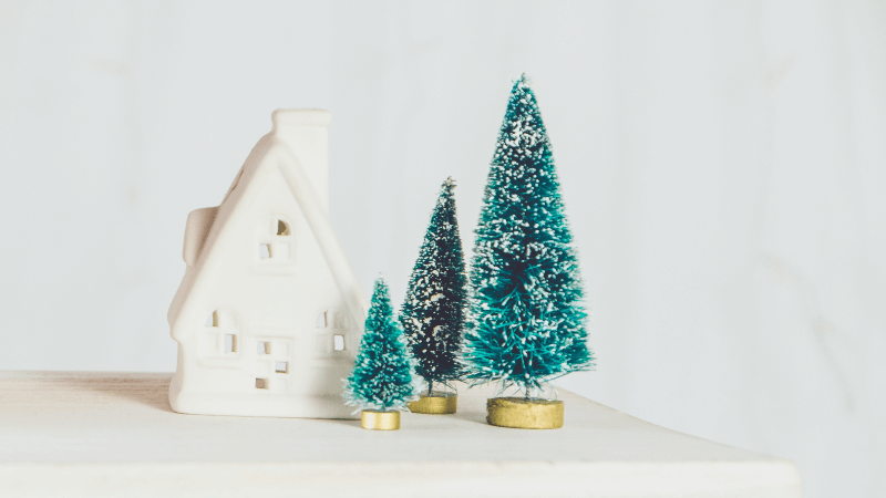 toy christmas tree and house shaped candle holder