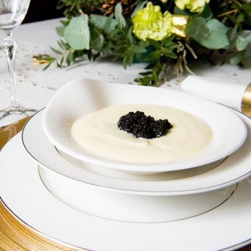 Crema de coliflor con perlas de arenque ahumado