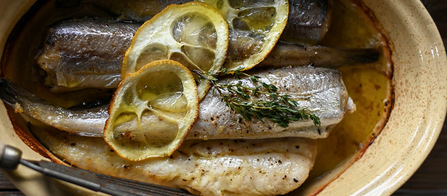 Hake fillets in dish with lemon slices