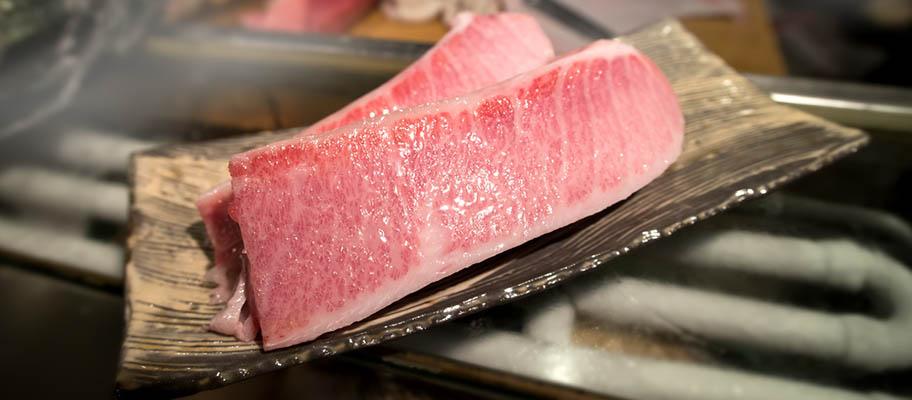 Raw tuna slices on dish