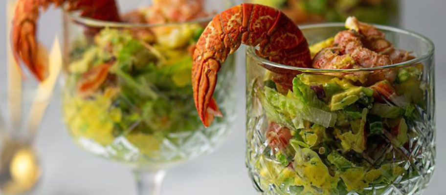 Lobster cocktail: two glasses filled with salad leaves and lobster tails