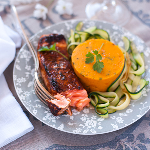 Caramelised salmon plated up with sweet potato purée and courgetti