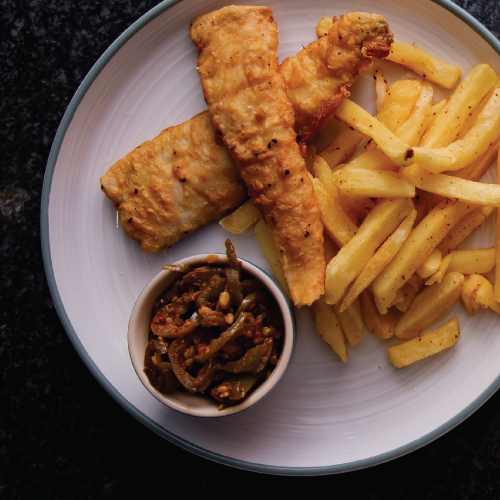 Beer battered hake and chips with artchar