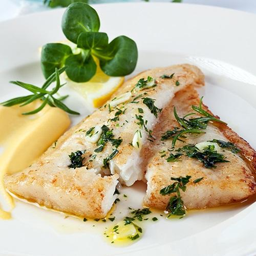 Pan fried hake with crisp sweet garlic