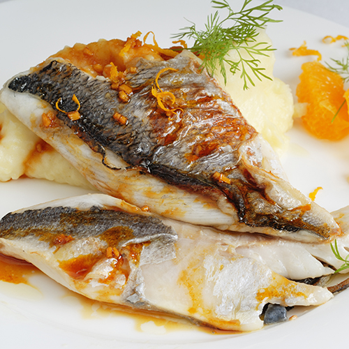 Hake with saffron and orange sauce and garnish