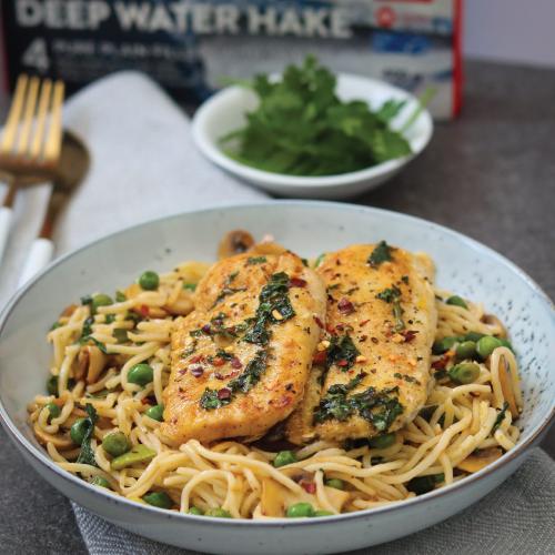 Pan-fried lemon & herb Cape hake with egg noodle stir-fry