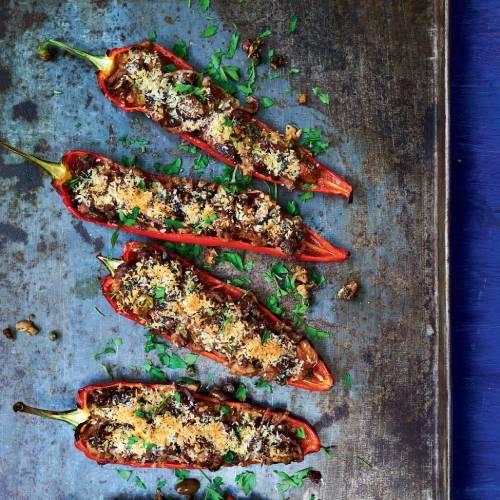 Tuna and olive stuffed romano peppers on a board