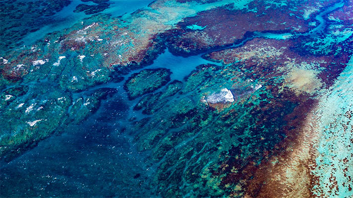 Aerial photo of ocean with reefs