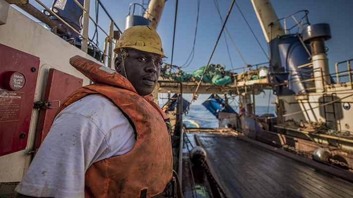 South African hake fisherman on deck looking past camera