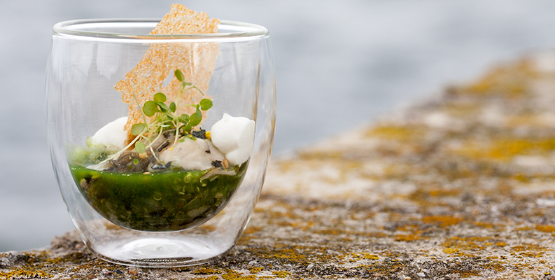 An oyster dish in a cup.