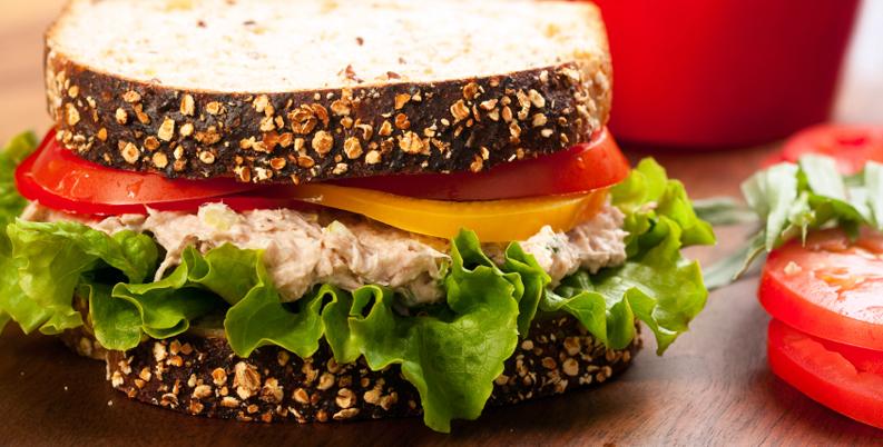 A closeup on a tuna sandwich.