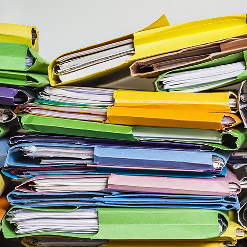 Piles of colourful document folders