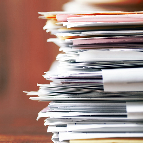 Large stack of files, red background