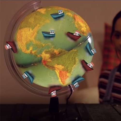 Globe with cartoon boats on it