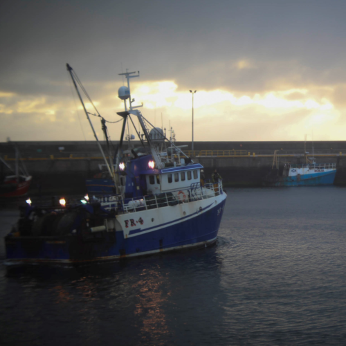 Project UK fishing vessel in harbour