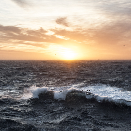 Sunset in the Southern Atlantic with a crashing wave