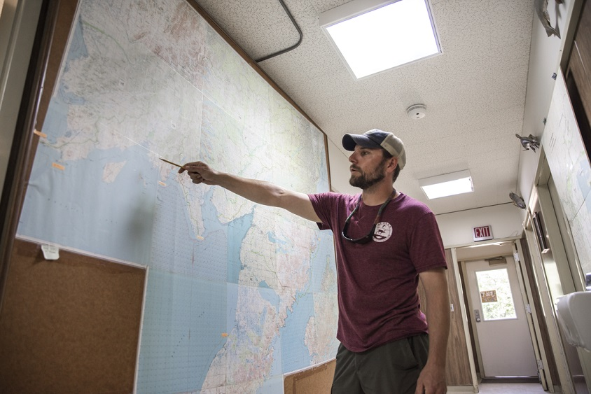Fishery manager pointing at map