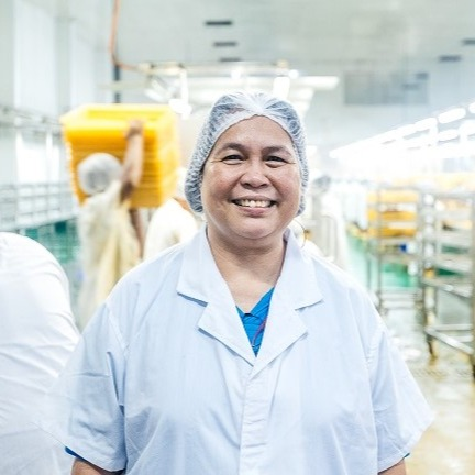 Woman working at a processing facility