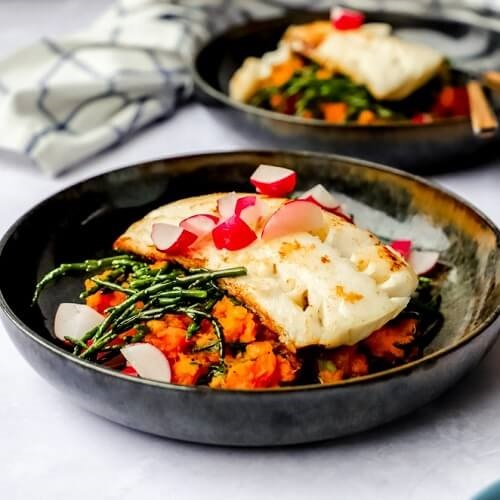 Schelvis met zoete aardappel-wortelpuree en zeekraal