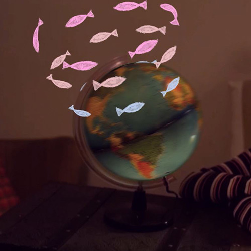 Spinning globe with illustrated school of fish